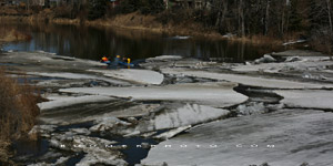 Kayakers get stuck in an ice jam on the Medicine river at Markerville, AB - April 12, 2009