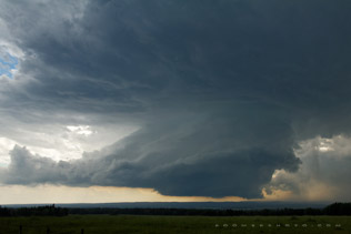 Supercell builds in the foothills southwest of Sundre - July 7, 2011