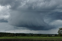 Thunderstorm trying to wrap up west of Innisfail, AB - June 9, 2012