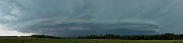 Thunderstorm rolling out of the Alberta foothills northwest of Sundre, Alberta - July 12, 2012