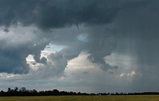 Tiny funnel cloud just east of Red Deer, AB - August 4, 2013