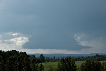 Wall cloud in the Alberta foothills west of Cow Lake, AB - August 13, 2013